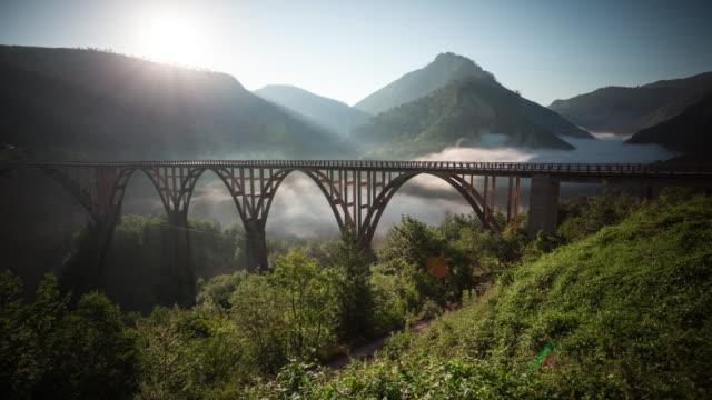 Durdevica Tara Bridge in mountains on sunrise. Time-lapse.