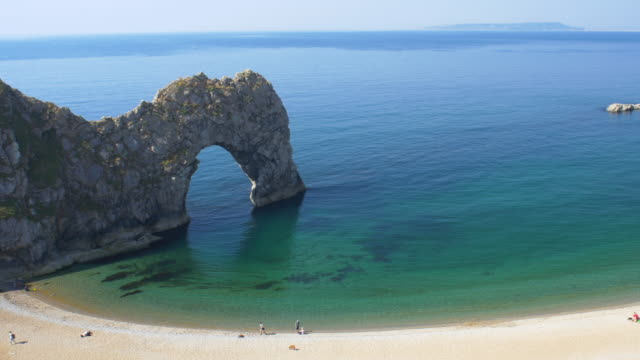 durdle door. jurassic coast. dorset, england. - arch stock videos & royalty-free footage