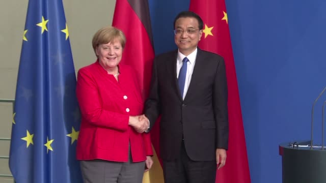 during a joint press conference with german chancellor angela merkel in berlin chinese premier li keqiang warns against protectionism and reiterates... - trade war stock videos & royalty-free footage