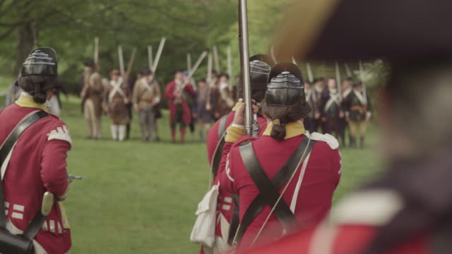during a revolutionary war battle reenactment british light infantry soldiers fire muskets at the colonial enemy. - infantry stock videos & royalty-free footage