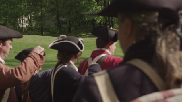 during a revolutionary war reenactment colonial soldiers load their muskets. - colonial reenactment stock videos & royalty-free footage