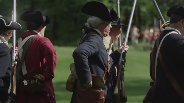 during a revolutionary war reenactment soldiers take musket ammunition out of cartridge bags. - war reenactment stock videos & royalty-free footage