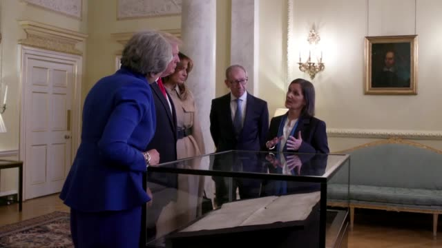 during a visit to downing street prime minister theresa may and us president donald trump along with melania trump and philip may view the sussex... - us president stock videos & royalty-free footage