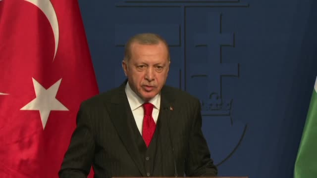 during a visit to hungary turkish president recep tayyip erdogan repeats his threat to open the gates for migrants to enter europe unless more... - recep tayyip erdoğan stock videos & royalty-free footage