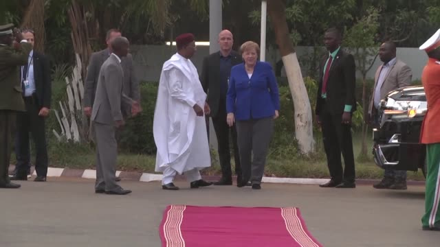during a visit to niger german chancellor angela merkel says creating jobs is necessary to fight traffickers and smugglers and help curb illegal... - mahamadou issoufou stock videos and b-roll footage