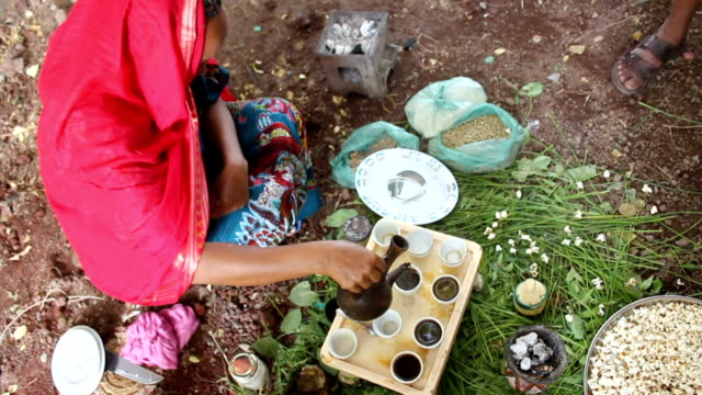 during coffee ceremony ethiopian woman coffee into cups on august 07, 2011 in logia, ethiopia - ethiopia stock videos & royalty-free footage
