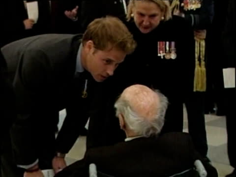 During first official solo engagement Prince William stoops to speak to wheelchair bound war veteran touching him on leg Wellington 03 Jul 05