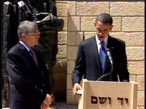 during his 2008 campaign for the presidency senator barack obama receives a book with an inscription from the curator of yad vashem the official... - curator stock videos & royalty-free footage