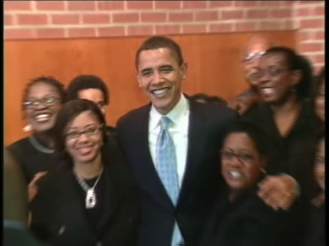 vidéos et rushes de during his 2008 presidential campaign, senator barack obama poses for a photo with supporters at a church in darlington, south carolina. - 2008