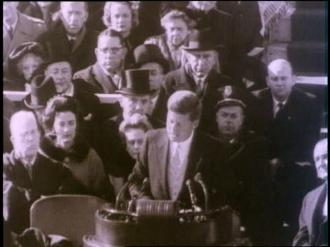 vídeos de stock, filmes e b-roll de during his inaugural address us president john f kennedy declares ask not what your country can do for you ask what you can do for your country - tomada de posse