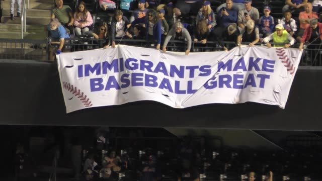 vídeos de stock, filmes e b-roll de during mets and phillie game at citifield protesters drop banner in the 6th inning of baseball game 'immigrants make baseball great' rise and resist... - flushing meadows corona park