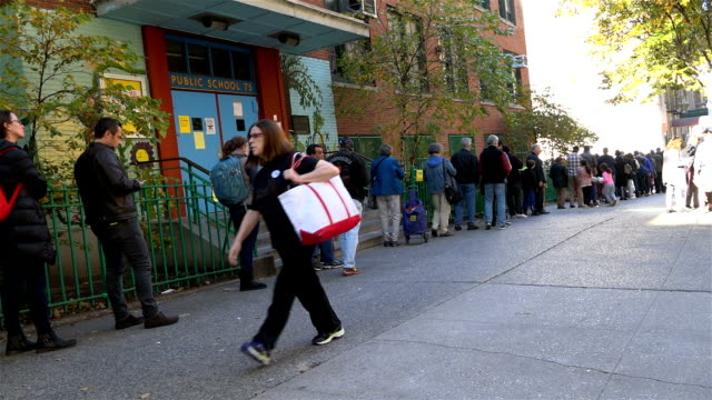 during midafternoon people stood in line to cast their vote at a nyc public school during the united states presidential election /upper west side ps... - united states presidential election stock videos & royalty-free footage
