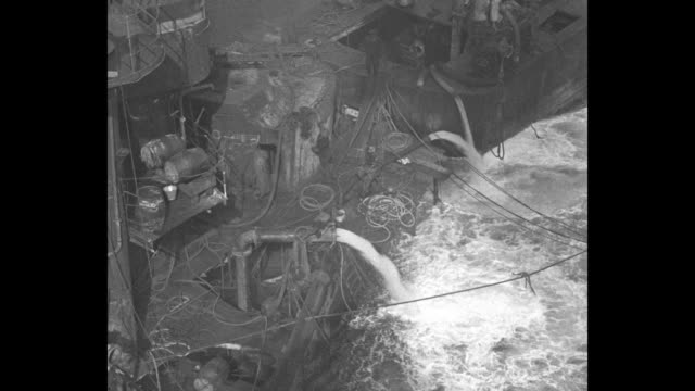 during salvage operations large amounts of seawater are pumped out of the ruined sms hindenburg and the crew assists a person in a diving suit up a... - diving helmet stock videos and b-roll footage