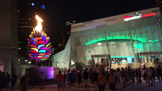 during the 2015 toronto pan american games the cauldron with the symbolic fire was placed in the cn tower plaza in the downtown district immediately... - cn tower bildbanksvideor och videomaterial från bakom kulisserna