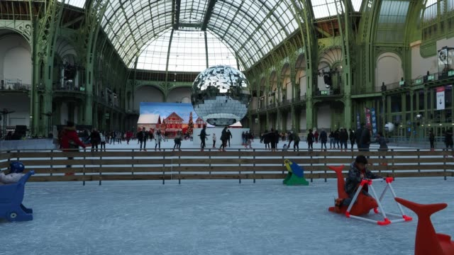 during the christmas holidays , the grand palais welcomes the largest ice rink – indoor ephemeral - in the world – december 13 paris - grand palais stock videos & royalty-free footage