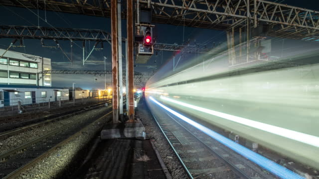 during the evening rush-hour at manchester picadilly train station numerous fast moving trains pass rapidly along the rail tracks arriving and departing from the station - electricity stock videos & royalty-free footage