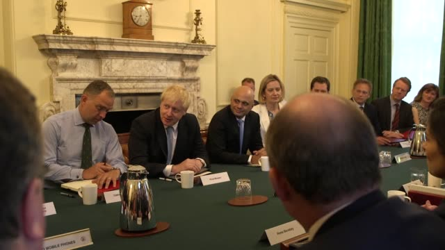during the first cabinet meeting of his premiership with cabinet secretary mark sedwill sat to his right and chancellor sajid javid on his left boris... - minister stock-videos und b-roll-filmmaterial