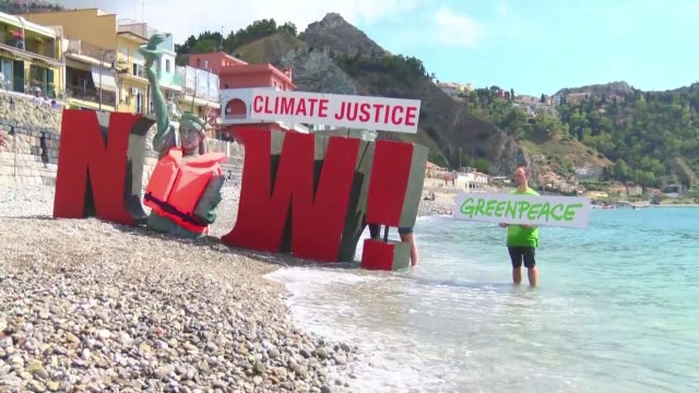 During the first day of the G7 in Taormina on the Italian island of Sicily Greenpeace's activists demonstrate on the beach of Giardini Naxos to alert...