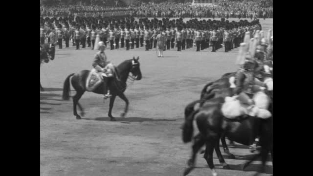 during the military parade for king george võs birthday the household cavalry rides by / the grenadier guard march by - honour guard stock videos & royalty-free footage