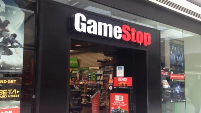 vídeos de stock, filmes e b-roll de during the pandemic, video game sales have broken records as millions of people stay home. - jogador de videogame