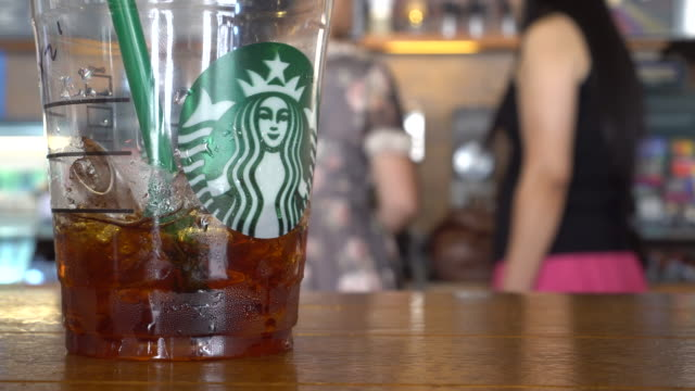 vídeos de stock, filmes e b-roll de during the third quarter 2016 starbucks china had $7682 million in sales a growth of 17% compared to the prior period - starbucks