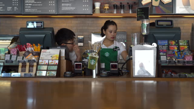during the third quarter 2016 starbucks china had $7682 million in sales a growth of 17% compared to the prior period - barista stock-videos und b-roll-filmmaterial