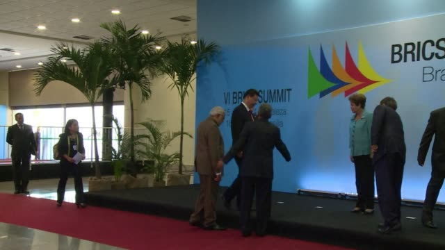 vídeos de stock, filmes e b-roll de during their summit in fortaleza brazil the brics group of emerging powers launched a $50 billion development bank tuesday to be based in shanghai... - newly industrialized country