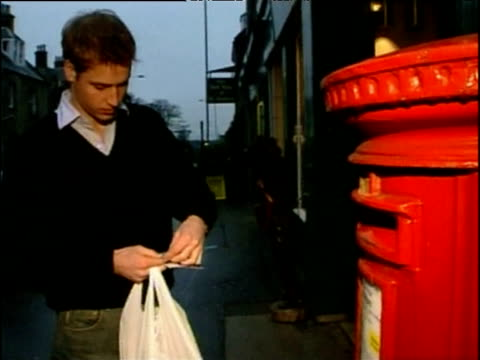 during time as student at st andrew's prince william puts stamp on letter and places into red post box scotland 15 dec 03 - mailbox stock videos and b-roll footage