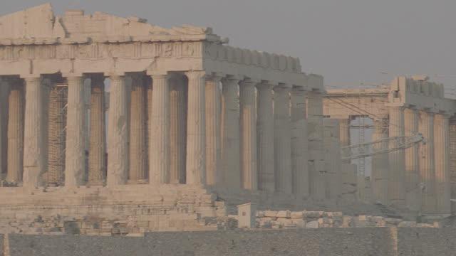 dusk acropolis, pan down to athens, greece - greece stock videos & royalty-free footage