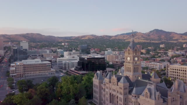 dusk aerial clip of skyscrapers state capitol building in the downtown financial district of salt lake city - mormonism stock videos & royalty-free footage