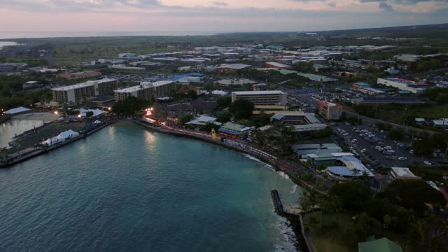 dusk aerial view of famous kailua-kona bay waterfront, hawaii, usa - big island hawaii islands stock videos & royalty-free footage