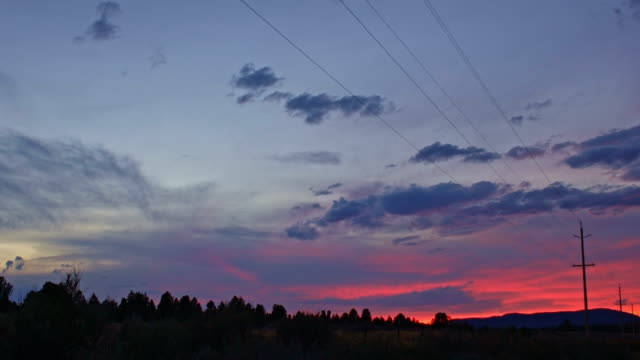 Dusk and power lines energy sunset in remote area