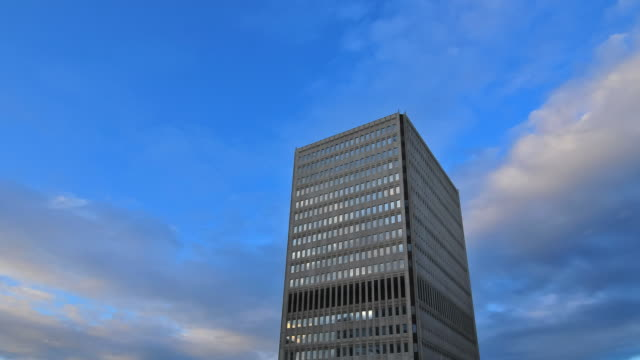 t/l ofdusk approaching single office tower - single object stock videos & royalty-free footage