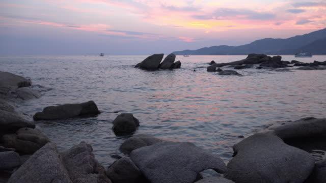 dusk at villasimius beach - spiaggia stock videos & royalty-free footage