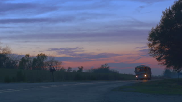 dusk bus runby, toward cam r-l - louisiana stock videos & royalty-free footage