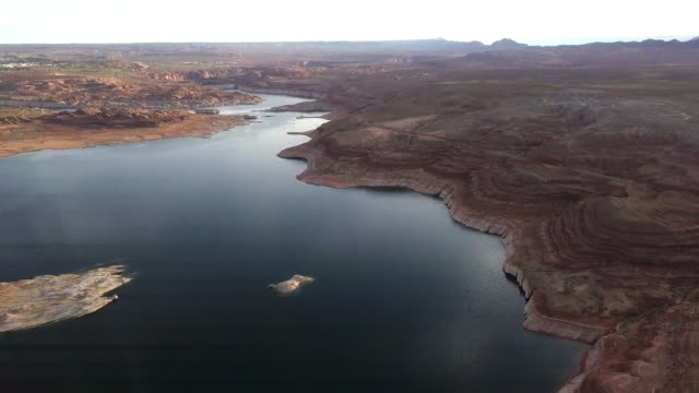 dusk drone footage of lake powell, wahweap bay near page arizona - sandstone stock videos & royalty-free footage