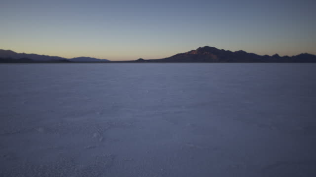 dusk in the bonneville salt flats. - bonneville salt flats stock videos and b-roll footage
