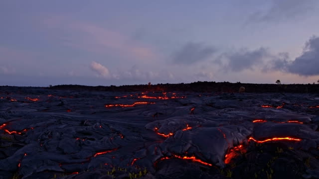 dusk night sunset over lava dusk sunset glowing hot flow from kilauea active volcano puu oo vent active volcano magma - lava stock videos & royalty-free footage