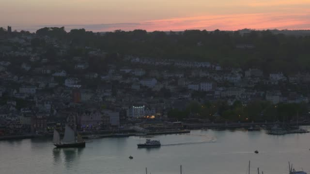 Dusk over Dartmouth Harbour with tall ship