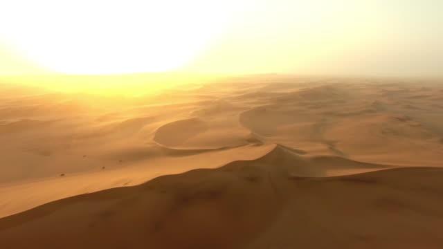 dusk over the dunes of the namibian desert - namibian desert stock videos and b-roll footage