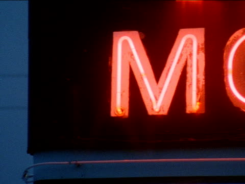 Dusk/ PreDawn sky amp neon Motel free standing sign w/ some patches of peeling paint 1950s Americana Heartland Nostalgia