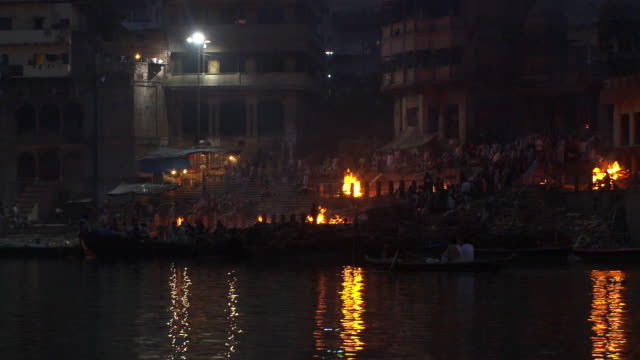 Dusk shot of a city shoreline on the Ganges in India.