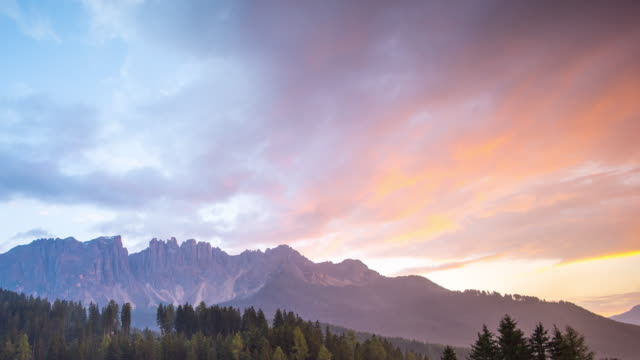 dusk sky timelapse,dolomite mountain - tree area stock videos & royalty-free footage
