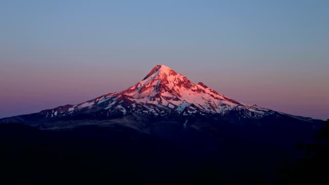 dusk sunset alpenglow on snowy mountain mt. hood - oregon us state stock videos & royalty-free footage