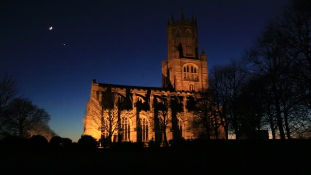 Dusk sunset, St Mary and All Saints church, Fotheringhay village, Northamptonshire, England, UK