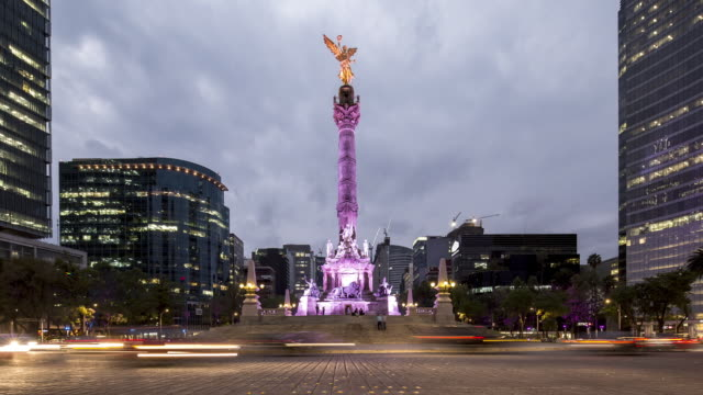 tl, ws dusk to night as traffic flows around el angel / mexico city, mexico - sculpture stock videos & royalty-free footage