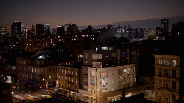 WS T/L Dusk to night at south across Bowery towards Financial District / New York City, New York, USA