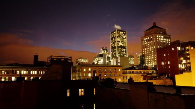 dusk to night time lapse looking at downtown district from old town montréal - vieux montréal stock-videos und b-roll-filmmaterial