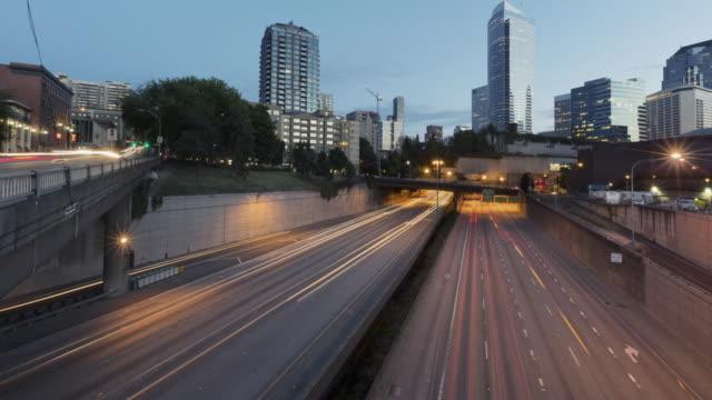 Dusk to night time lapse of free flowing freeway traffic
