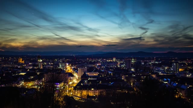 dusk to night time lapse of freiburg - germany stock videos & royalty-free footage